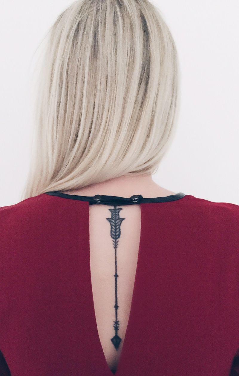 Back arrow tattoo